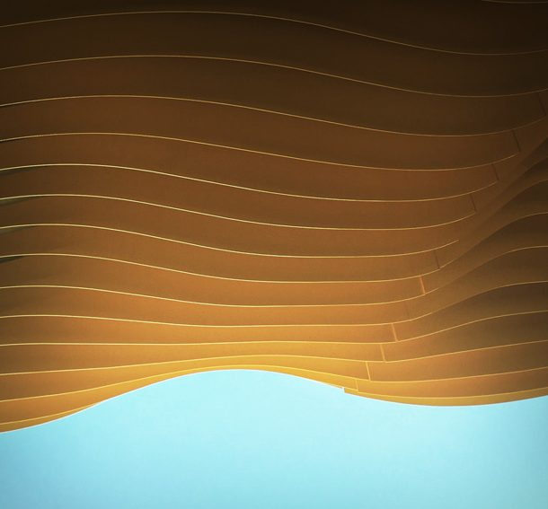 Abstract photo of yellow Drift Inversion sculpture and blue sky