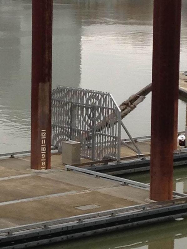 Metal gate with rippling pattern artwork on dock