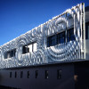 A large aluminum sculpture of ripples in Portland OR.