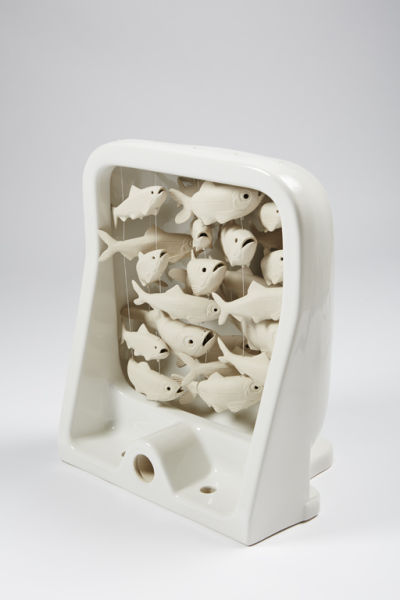 ceramic school of fish in a hospital ware sink
