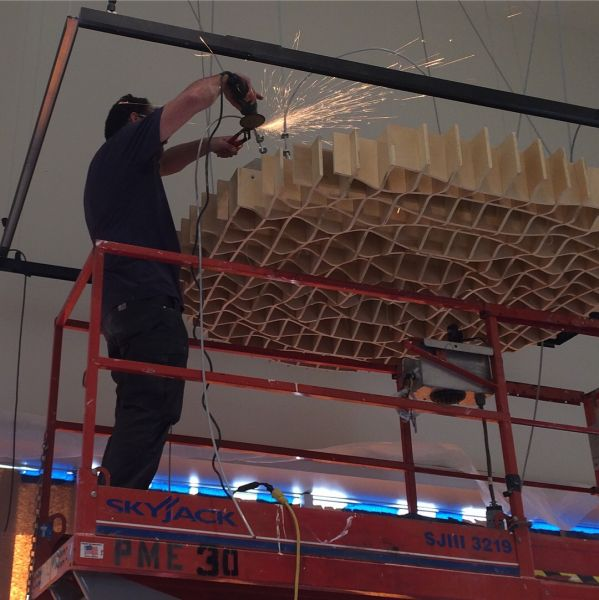 Installing the structure that the Ghost School is hung from