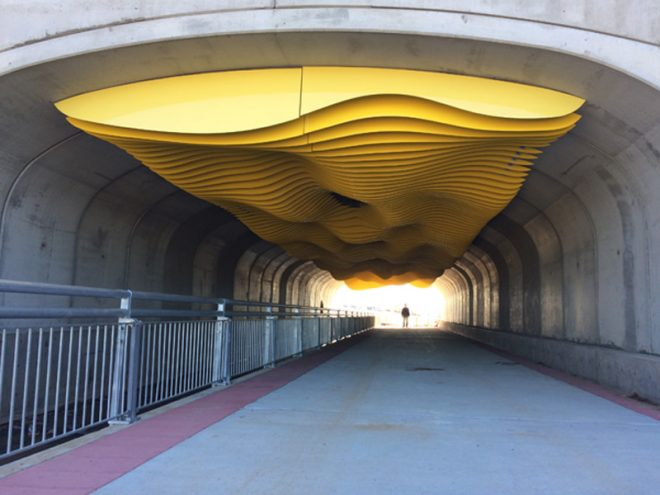 This 23' x 128' installation is an inverted sculpture of sand dune forms. It is installed in a pedestrian underpass tunnel under Central Park Boulevard between 53rd and 54th in Denver, Colorado