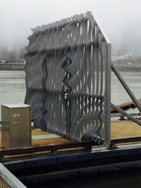Dock gate with rippling pattern artwork, Portland in background