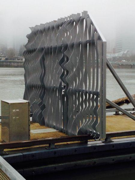 Dock gate with rippling pattern artwork, Portland in background