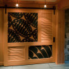 Sliding door painted and carved to represent waves and a pattern of Lined Chitons