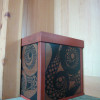 Box with painted and carved tentacle design