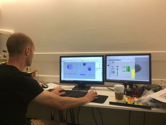 Aaron Whelton working with two monitors