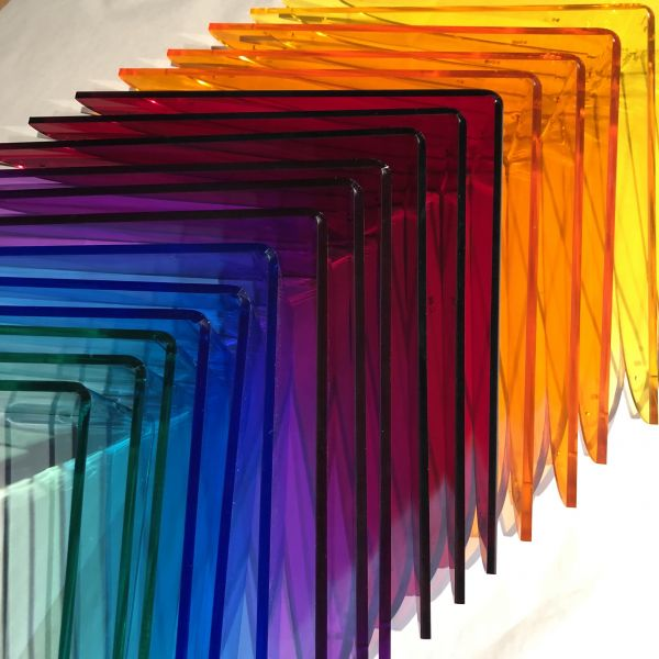 The colorful acrylic bird forms that make up the Flight of the Spectrum Sculpture