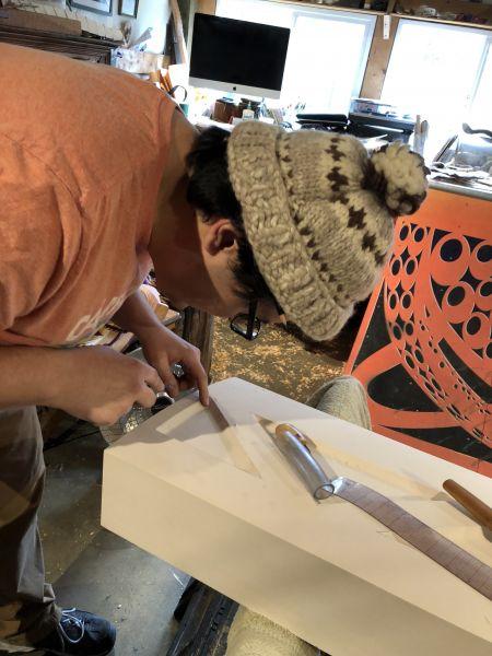 Anthony Jones Sr. carving the details